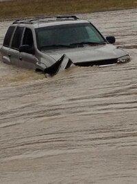 vehicle in flood water.jpg
